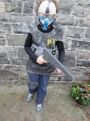 <h5>Hunt N.S Mohill</h5><p>Milo O Driscoll, 5th Class, St. John's N.S., Logboy, Tulrahan, Claremorris, Co. Mayo. Milo made his costume with bubblewrap, wood, old newspapers, old trousers, a broken mask and string.</p>