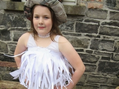 <h5>Hunt NS, Mohill</h5><p>Holly Hanrahan, 5th Class, Hunt N.S.  She made her costume with old paper, newspaper and old ribbon. </p>