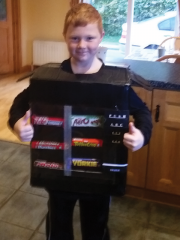 <h5>Daniel, vending machine</h5><p>Daniel, his DIY costume is a vending machine.</p>