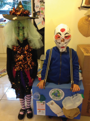 <h5>Witch and Recycling bin</h5><p>Caroline Stallard sent in this pict of her two kids heading off for school this morning with their homemade recycled costumes. Her son was a recycling bin with a skeleton mask made from recycled printing paper. Her daughter's witches hat was made from cereal boxes and black tissue paper. Her mask was made from a cereal box and green newspaper cuttings.  </p>